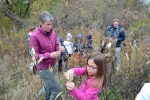 Secretary Sally Jewell helps Minneapolis second graders collect native prairie seeds during her visit to Minnesota Valley National Wildlife Refuge.