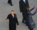 President Barack Obama and First Lady Michelle Obama wave.