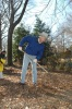 Secretary Salazar raking leaves near the DC War Memorial.