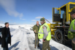 Secretary Zinke with Park employees next to snow removing vehicle