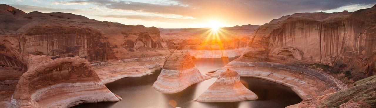 A sunburst captured at sunrise in Glen Canyon National Recreation Area, Utah