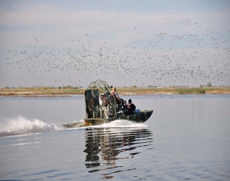 US Fish and Wildlife Employees on Airboat