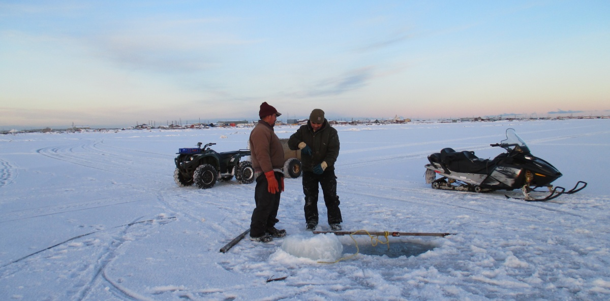 Members of the Iñupiaq community ice-fishing