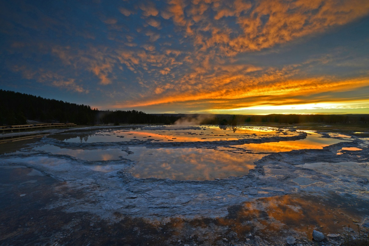 golden skies and steaming geyser
