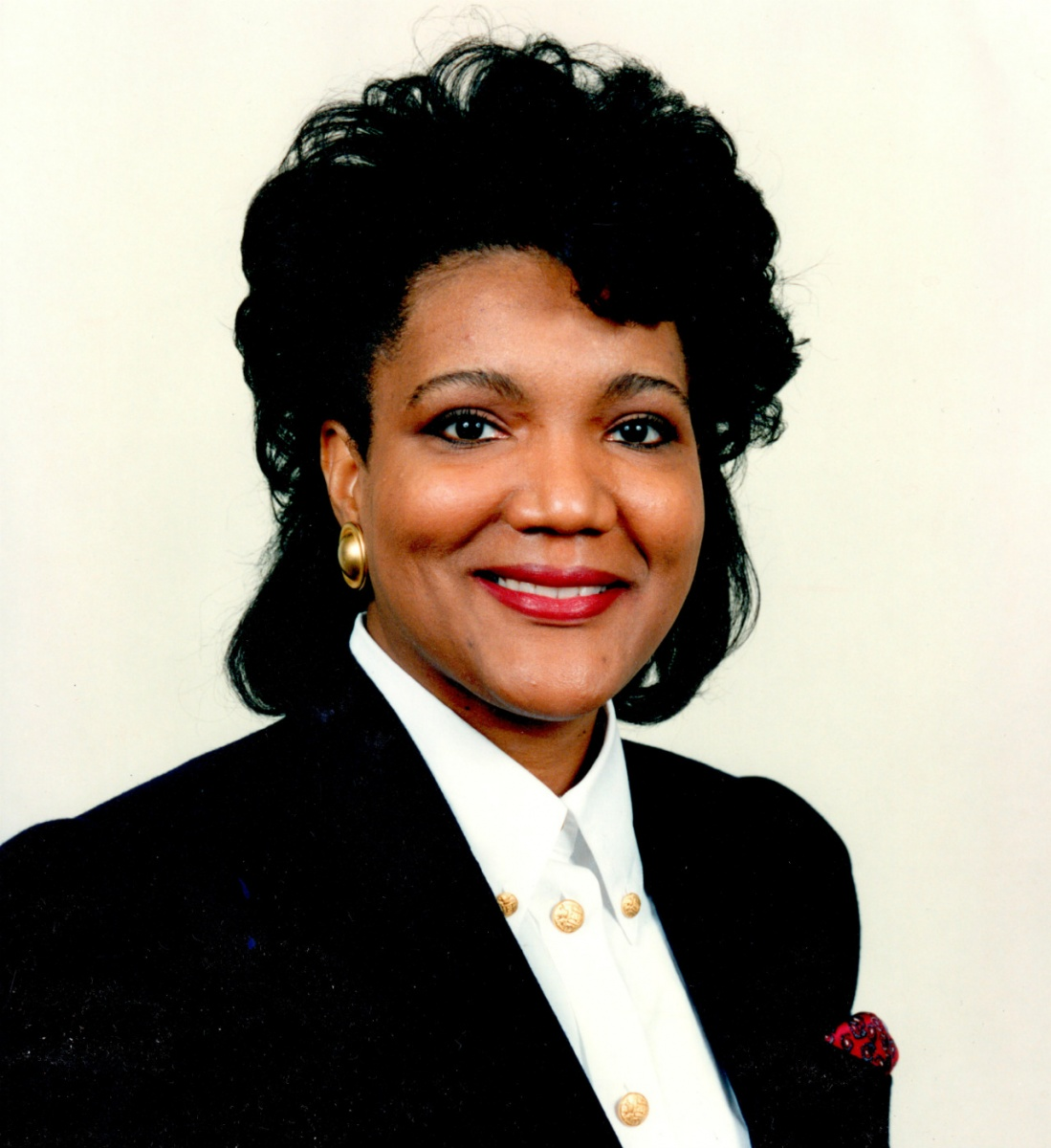 Photo of Cynthia Quaterman -- an African American woman wearing a business suit and smiling at the camera.