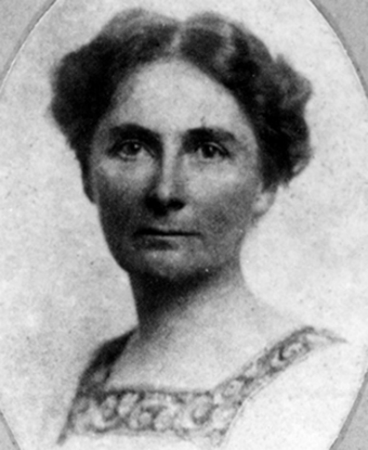 A historic photo of a woman with dark hair looking at the camera.