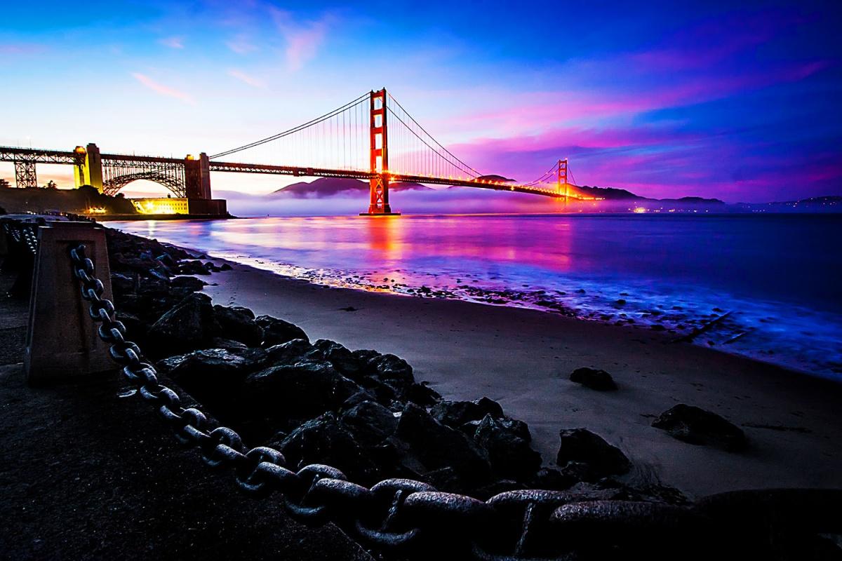 pink and blue sky, golden gate bridge, black shoreline