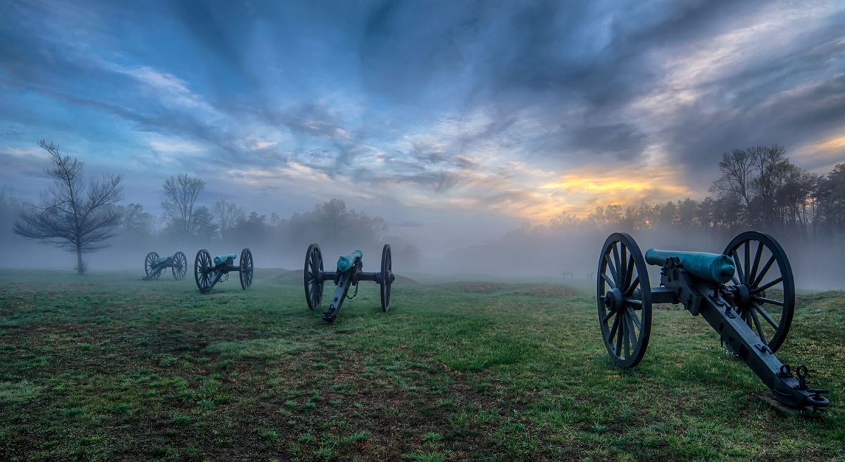 green grass, cannons, fog