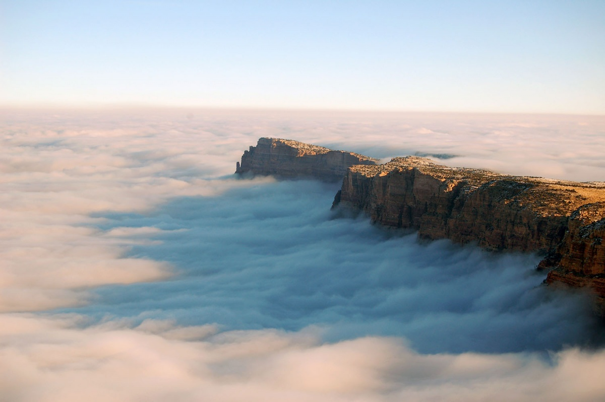 An ocean of clouds fills the Grand Canyon, leaving only the tops of rock exposed