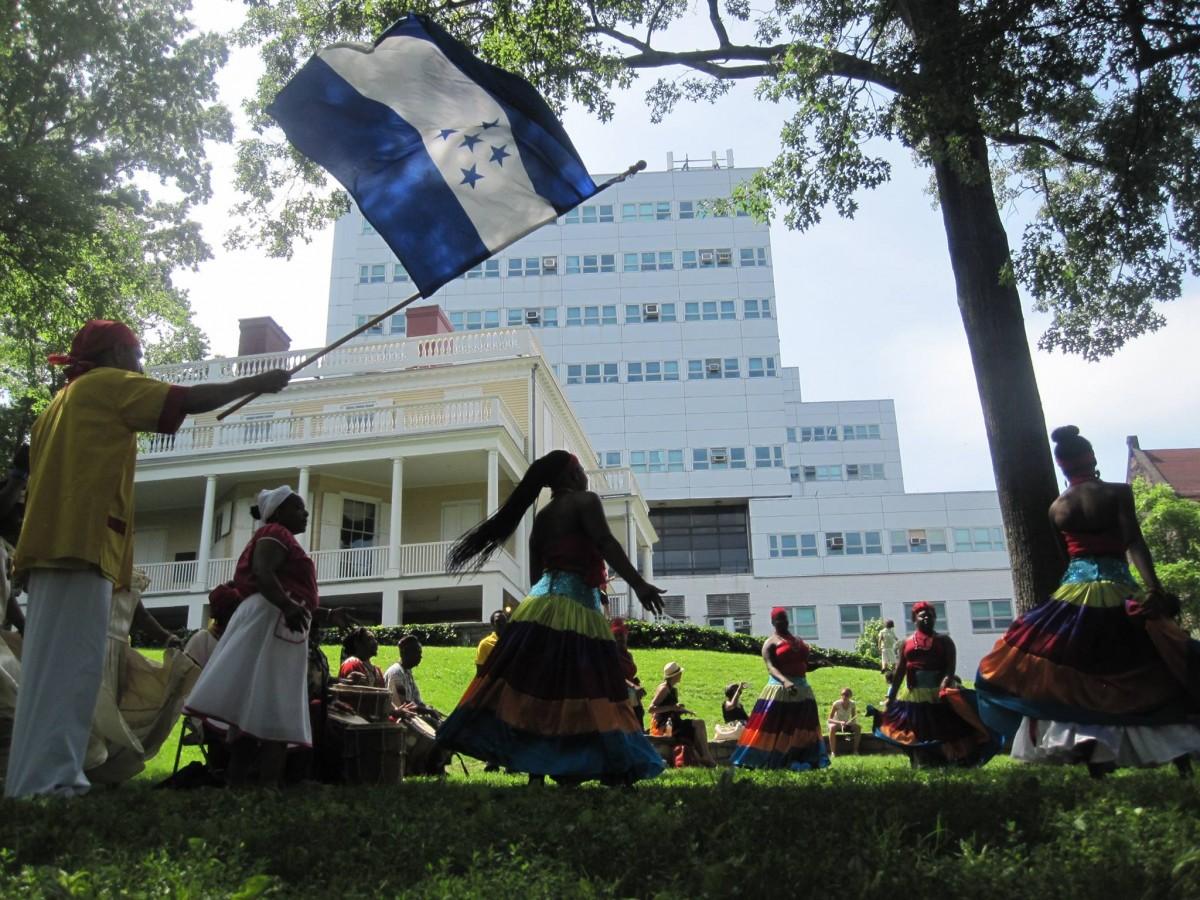 Colorful dancers on grass at Hamilton Grange National Memorial.