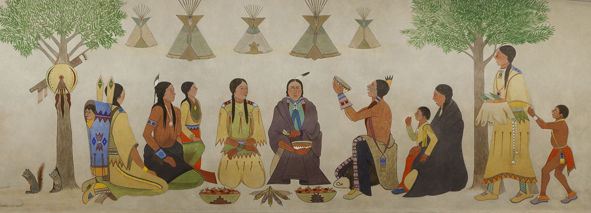 A painting of Native Americans in traditional clothes sharing food.