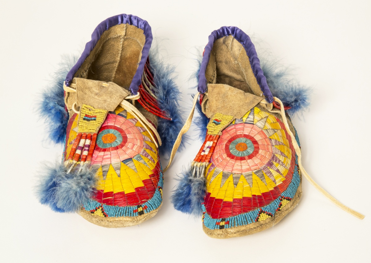 An elaborately decorated pair of Native American shoes.