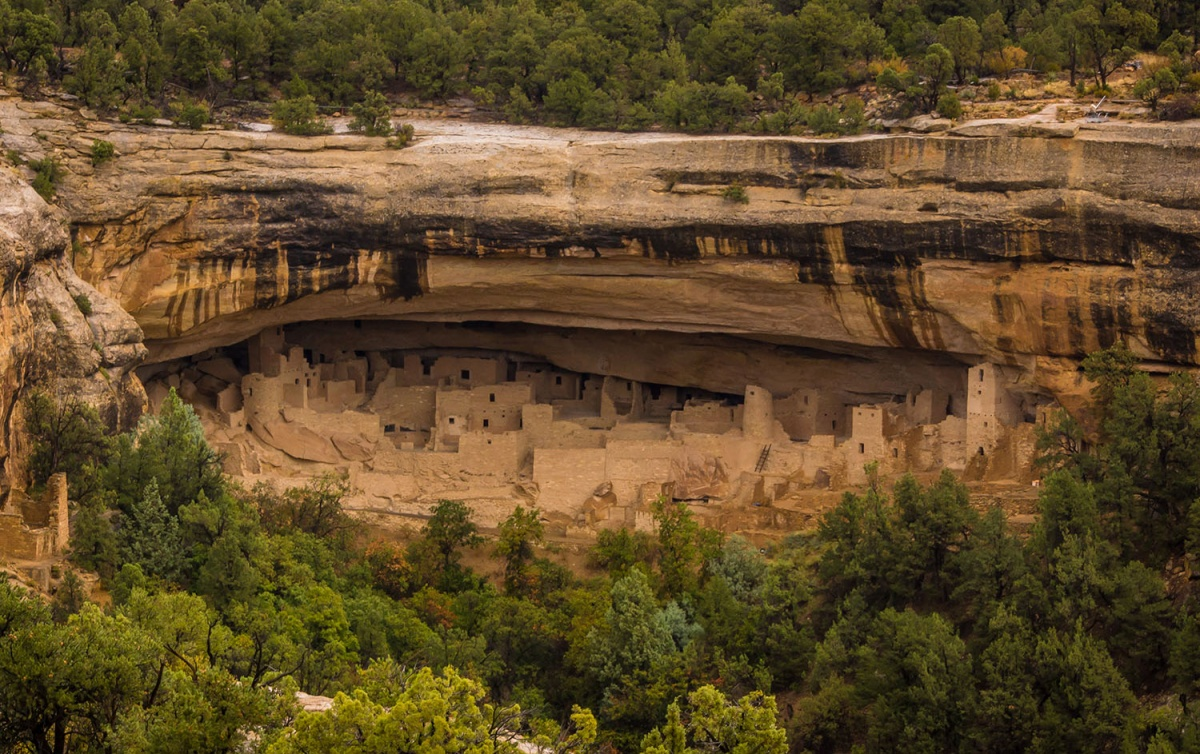 cliff dwellings in the side of a mountain