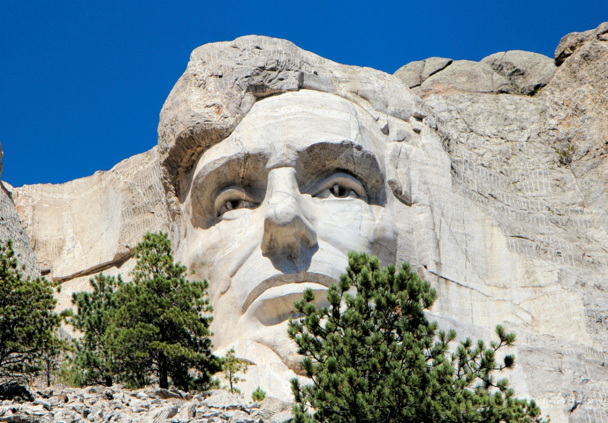 The sculpture of Abraham Lincoln's face looks out from the side of Mount Rushmore.