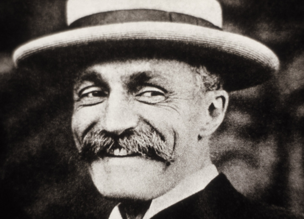 Gifford Pinchot smiles in a black and white photo close up of his face.