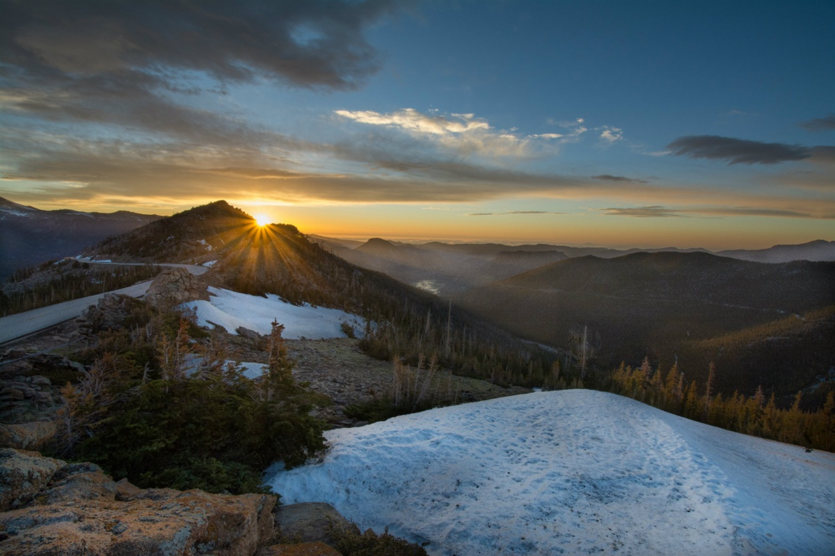 Sunrise over a mountain with snow in Rocky Mountain National Park