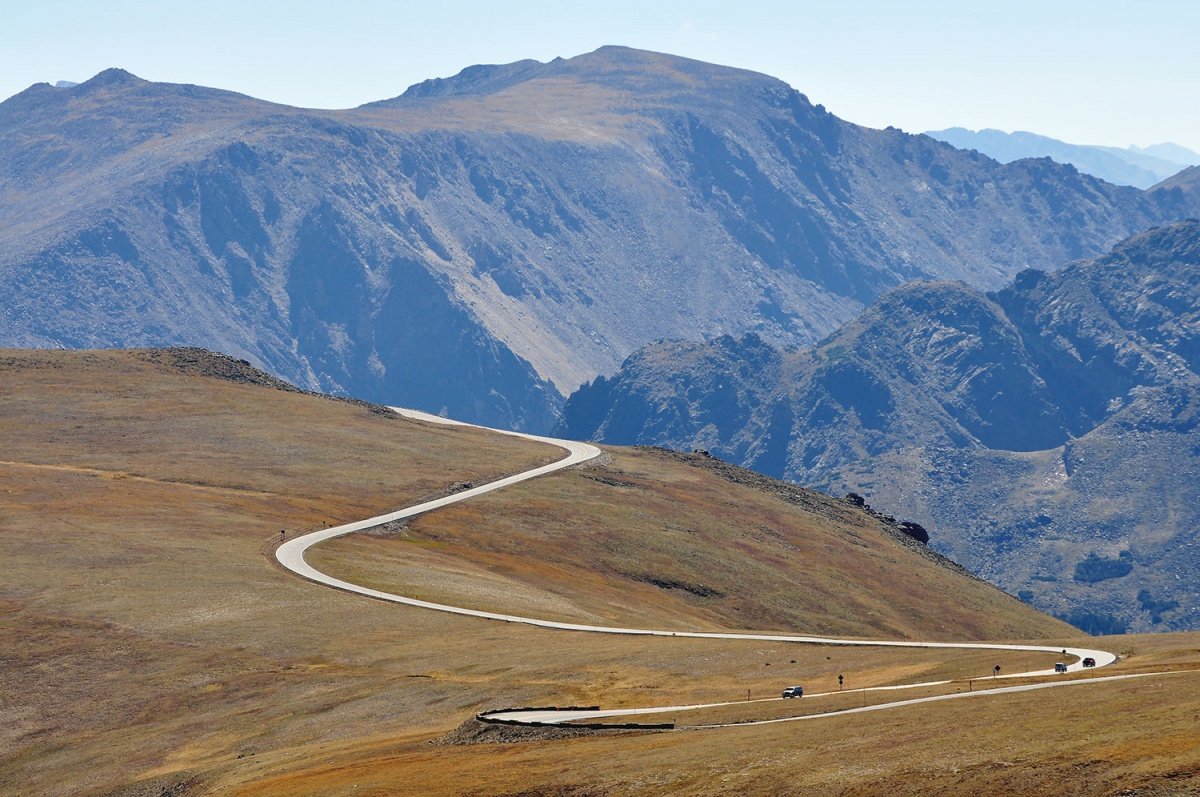 A road winds through the mountainside