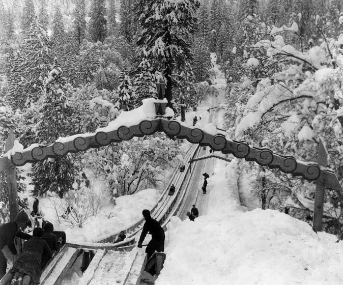 kids sledding down a snowy run