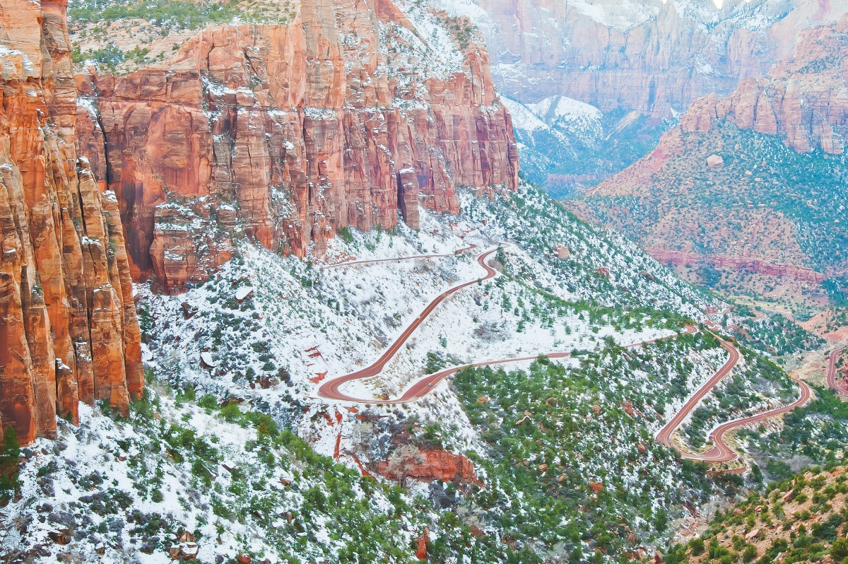 Zion-Mt. Carmel Highway winding up a mountain topped with snow
