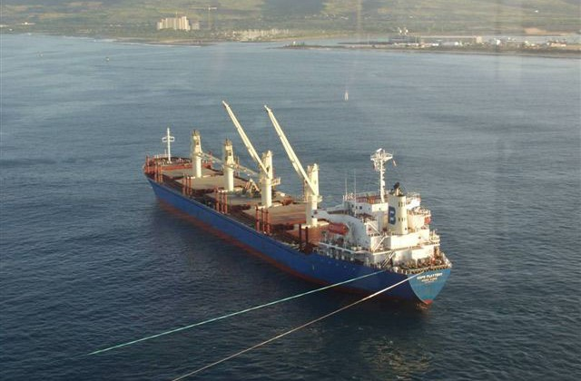 The M/V Cape Flattery, a 555-foot long cargo ship carrying pelletized cement, shown here in February 2005, anchored at sea offshore Barbers Point on the southwestern shore of Oahu, Hawaii
