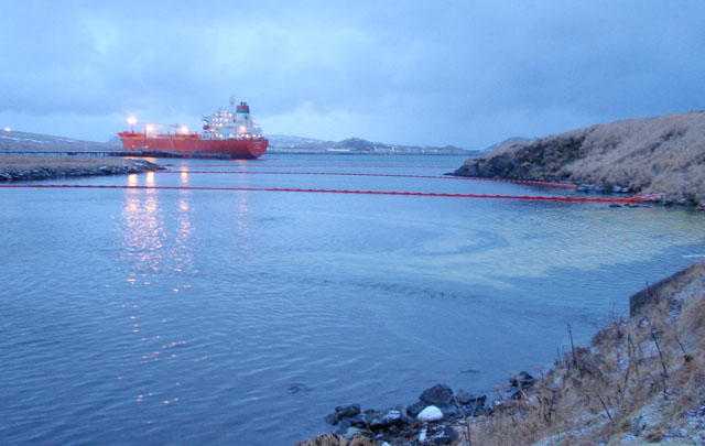 oil spill containment booms stretched across Sweeper Cover and Adak Small Boat Harbor on Adak Island, Alaska, in January 2010