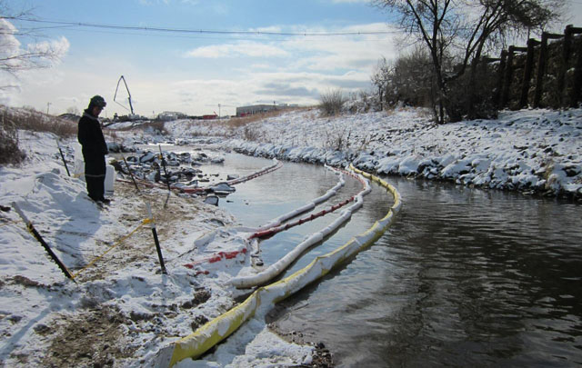 sorbent booms stretched across Sand Creek in December 2011, near Commerce City, Colorado